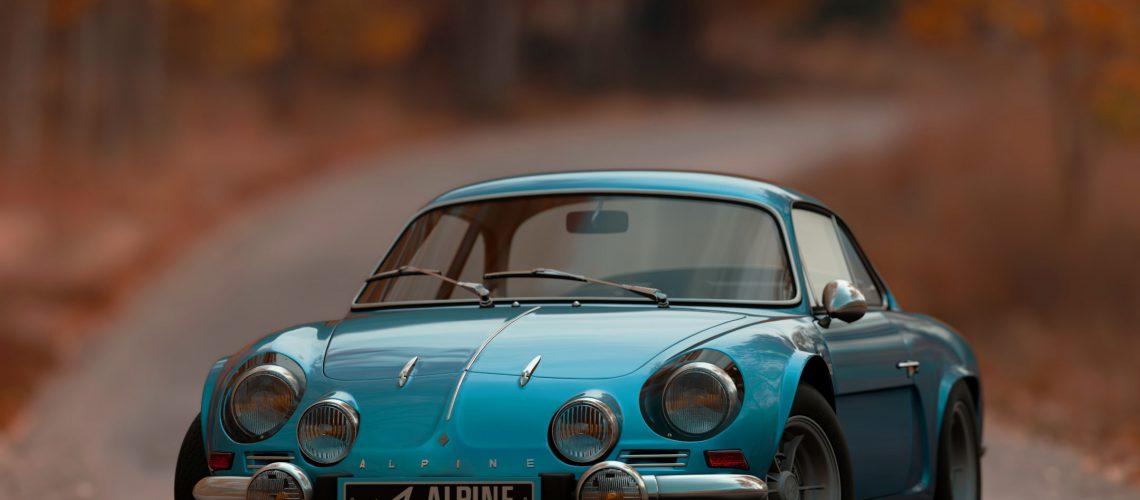 shallow-focus-photography-of-blue-alpine-car-1592384